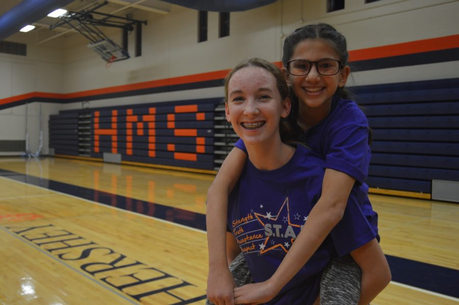 Eighth graders Stella Mundi, right, and Sydney Hampston, left, pose for a picture before heading to a Zumba class. (Broadcaster/Elaina Joyner)