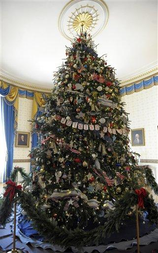 The official White House Christmas tree, an 18-foot-6-inch Frasier fur from Jefferson, N.C., is trimmed with ornaments decorated by children of military families in the Blue Room of the White House in White House in Washington, Wednesday, Nov. 28, 2012, during a preview of the holiday decorations. The theme for the White House Christmas 2012 is Joy to All. (AP Photo/Susan Walsh)