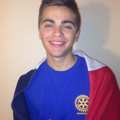 Théo Nunes, Rotary exchange student from France, poses with his French flag after sharing his ideas about what teenage drinking in France is like. Nunes came the Unites States during mid August. (Broadcaster/Moxie Thompson )