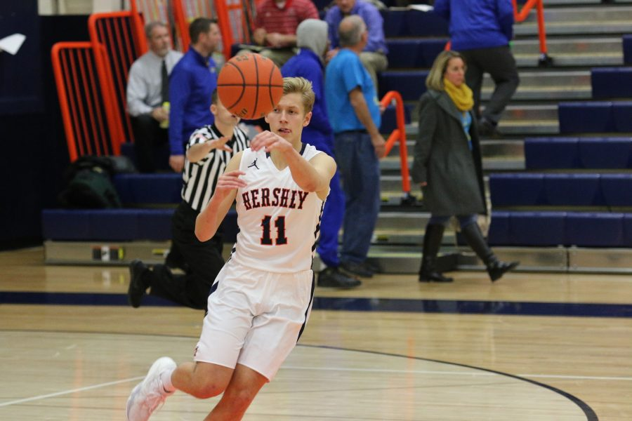 Junior Jake Wilson passes the ball during Friday's game against Cocalico. Wilson scored 11 points for the Trojans on Friday December 10, 2016 at Hersey High School. (Broadcaster/ Marisa Balanda)