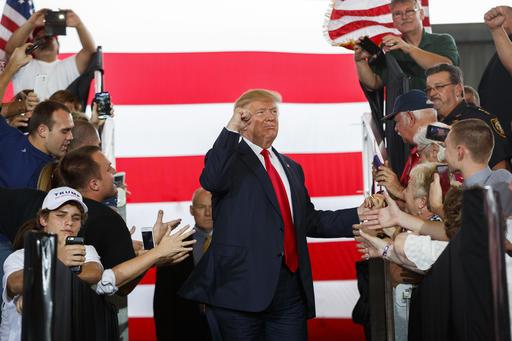 On October 12, Donald Trump arrives at a rally in Ocala, Fla. On the campaign trail, Trump made the uncommon move of releasing his list of potential supreme court nominees. (AP Photo/ Evan Vucci)