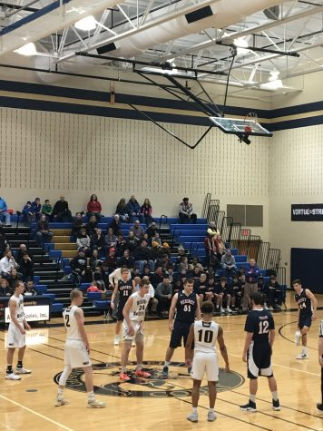 The HHS trojans awaited the jump ball to begin the game, with sophomore Drew Painter starting for the jump. (Broadcaster/ Molly Glus)