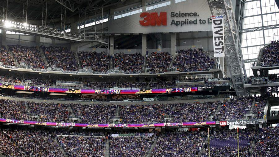 The seats directly under protesters were cleared of fans for safety reasons after #NoDAPL protesters hung a sign from the rafters as the Vikings play host to the Bears at U.S. Bank Stadium. (Chicago Tribune)
