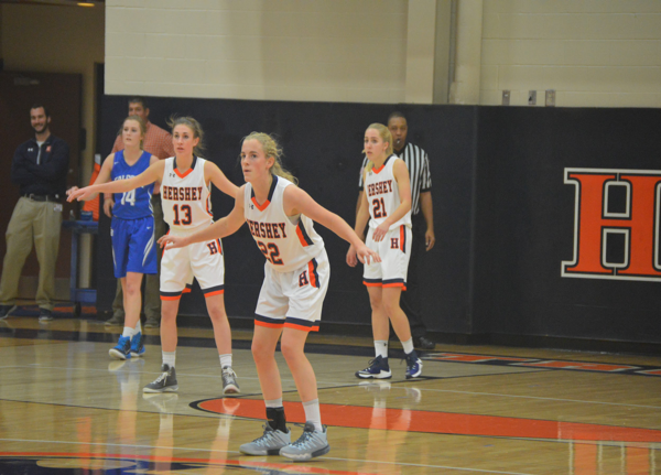 Juniors Cassie Zugay (center) and Annie Cotton (right) with senior Jacquiline Foley (left) stand together to make a strong defense. Positions are taken and their minds are focused; they're ready to play.