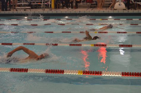 Hershey senior Grant Geyer swims in the 200M freestyle race against Mifflin County on Thursday, December 22, 2016. Geyer placed second with only .42 seconds behind first place. (Broadcaster/Shanna Sweitzer)