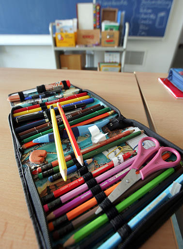 A pencil case is seen on a table inside a classroom in an elementary school in Frankfurt/Main, Germany, on Wednesday, January 18, 2006. (AP Photo/Michael Probst)