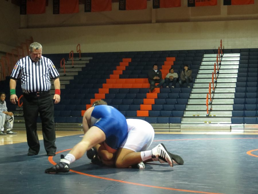 Jacob Gore, in white, struggles to hold on to his opponent on February 2, 2017. As a senior, this was Gore's last wrestling match. (Broadcaster/Echo Rogers)