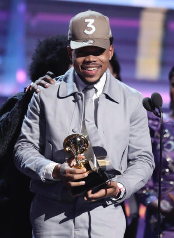 Chance The Rapper accepts the award for best rap album for Coloring Book at the 59th annual Grammy Awards on Sunday, Feb. 12, 2017. Chance made history by becoming  the first streaming-only artist to win a Grammy.  (Photo by Matt Sayles/Invision/AP)