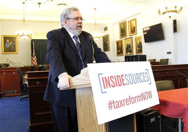 Pulitzer Prize winning reporter and author David Cay Johnston moderates a discussion about the challenges of the current tax code at the
