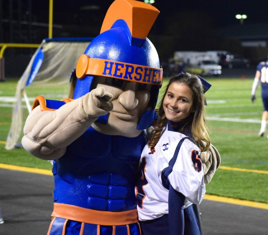 Friday, November 11, 2016, Troy the Trojan poses with HHS Senior and cheerleader Bella Flynn during the HHS football team's last game against Lower Dauphin. Lower Dauphin beat Hershey 28-0. (Broadcaster/Mallory Drayer)
