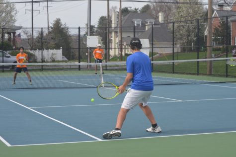 On Monday, April 10 Druv Tripathi (left) and Shengdi You (right) play doubles for HHS against Lower Dauphin. The HHS double pair won the match including a 6-4 final set. (Broadcaster/ Emily Tubbs)