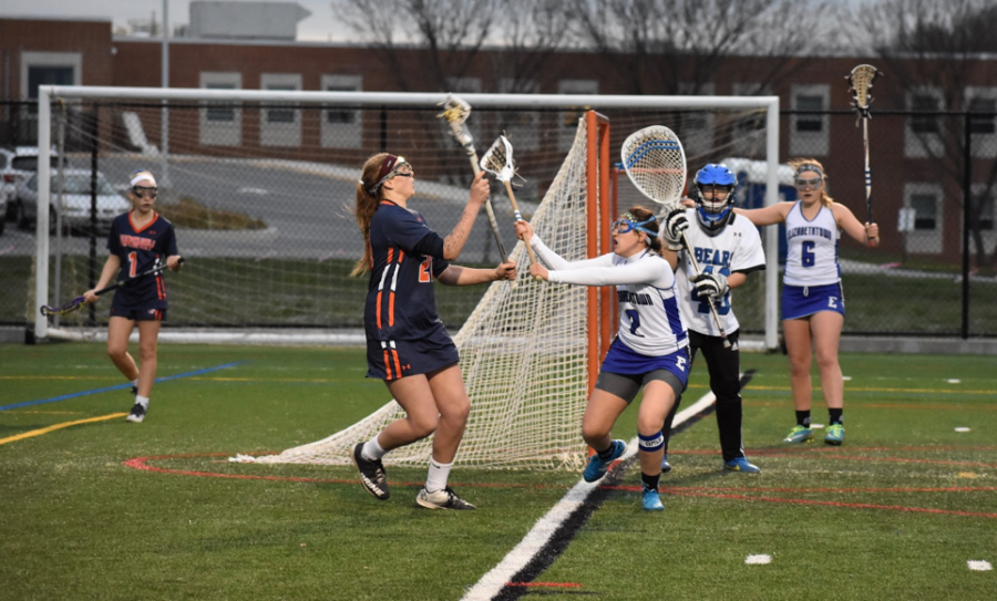 Payton Bouslough, center, receiving a pass from a teammate during the first half of the game. Hershey beat Elizabethtown 19-3 on Monday, April 3, 2017. (Broadcaster/Mallory Drayer)