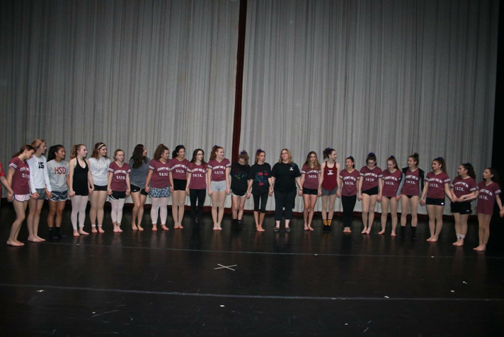 Dancers come together before the beginning of the show. They held hands and prepared for the first night of their performance. (Submitted/Hollis Healy)