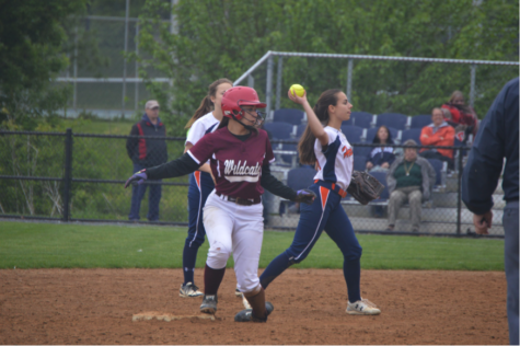 Claire Sheppard, freshman, throws the ball back to the pitcher after a Mechanicsburg hit. (Broadcaster/Moxie Thompson)