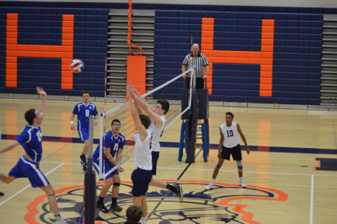 Senior Jack Quillen and Junior Jordan Spidle jump above the net to block a shot from a Lower Dauphin player. The Falcons later went on to win the game. (Broadcaster/ Madi Held)