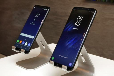 In this Friday, March 24, 2017, photo, new Samsung Galaxy S8, left, and Galaxy S8 Plus mobile phones are displayed in New York. The Galaxy S8 features a larger display than its predecessor, the Galaxy S7, and sports a voice assistant intended to rival Siri and Google Assistant. (AP Photo/Richard Drew)  In this Friday, March 24, 2017, photo, new Samsung Galaxy S8, left, and Galaxy S8 Plus mobile phones are displayed in New York. The Galaxy S8 features a larger display than its predecessor, the Galaxy S7, and sports a voice assistant intended to rival Siri and Google Assistant. (AP Photo/Richard Drew)