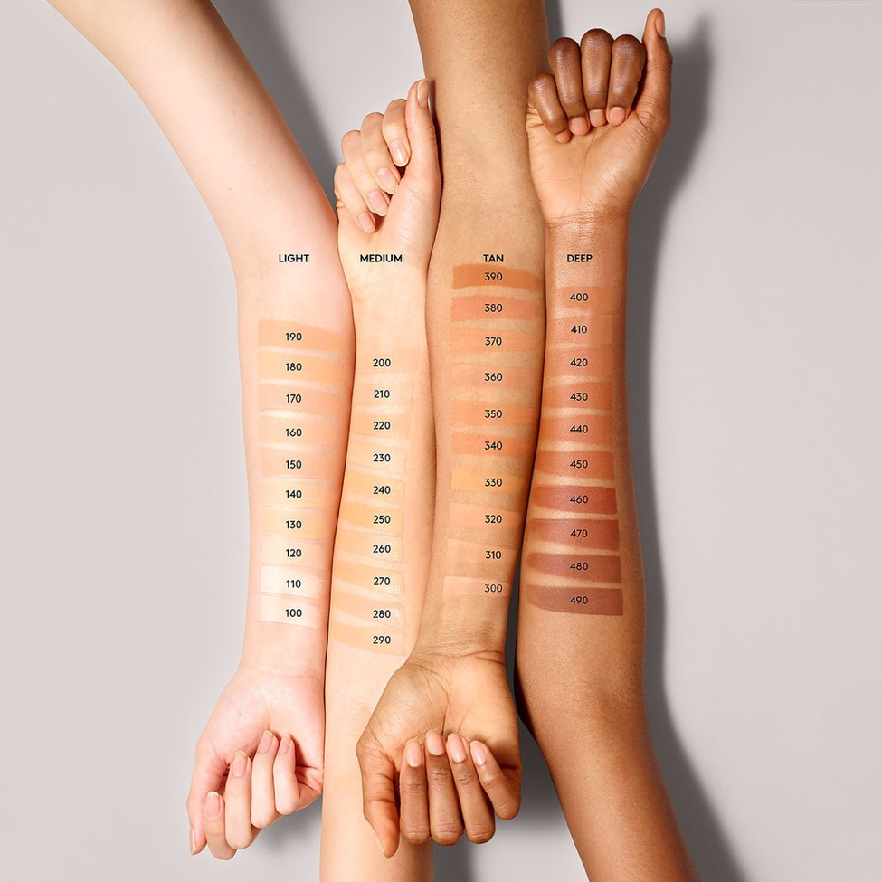 Pictured are four arms showcasing the wide variety of foundations from Fenty Beauty to fit nearly any skin tone.  This product range is unique because of the wide variety of shades; previously foundation came in 10 to 15 shades.  (Photo courtesy of Fenty Beauty)