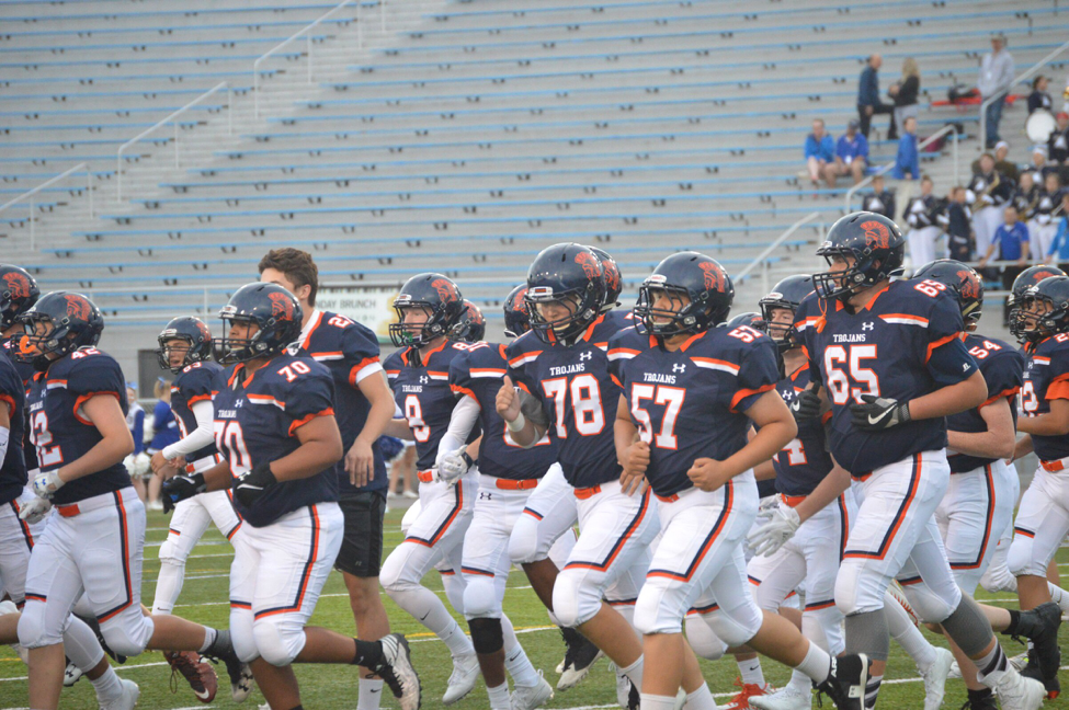 The HHS football team runs on the field as a team, warming up before they take on Spring Grove. Hershey is coming off of a 1-9 record in 2016. (Anna Levin/ Broadcaster)