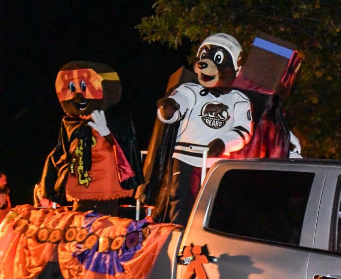 The Hershey Bear's and Reese's Cup mascots wave and throw candy to parade-watchers. The Hershey Halloween parade wouldn't have been the same without some of its favorite characters! (Broadcaster/Claire Sheppard)