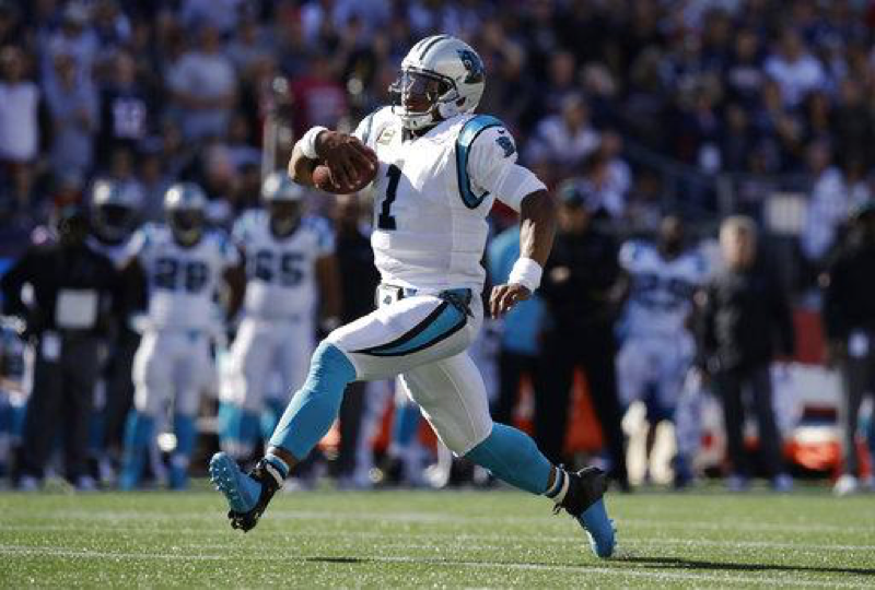 Quarterback Cam Newton rushing during the Panthers' week four matchup against the New England Patriots on Sunday, October 1st, 2017. (AP Images/Charles Krupa)