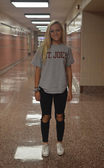 Junior+Taylor+Yahn%2C+pictured+above%2C+styles+black+ripped+jeans+with+a+college+t-shirt.+Yahn+adds+a+light+blue+scrunchie+and+white+sneakers+to+complete+her+look.+%28Broadcaster%2FElaina+Joyner%29