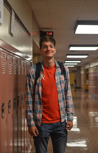 Senior+Dante+Falcucci+poses+for+a+picture+of+his+trendy+outfit+for+the+school+day.+Falcucci+wears+a+red+and+blue+flannel+to+add+to+his+regular+red+t-shirt.+%28Broadcaster%2FElaina+Joyner%29+