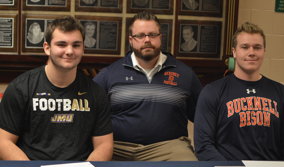 Drew Painter (left) and Daniel Sheehan (right) are pictured with Coach Frank Isenberg (center.) Both Painter and Sheehan signed on December 21, 2017. (Broadcaster/Anna Levin)