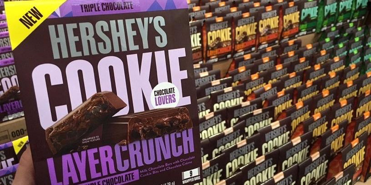 "Hershey's 4th Cookie Layer Crunch, ""Triple Chocolate"" in front of the previous flavors. Starting Dec. 4, Hershey's Cookie Layer crunch is for sale at Hershey's Chocolate World. (via Hershey's Chocolate World Twitter)"