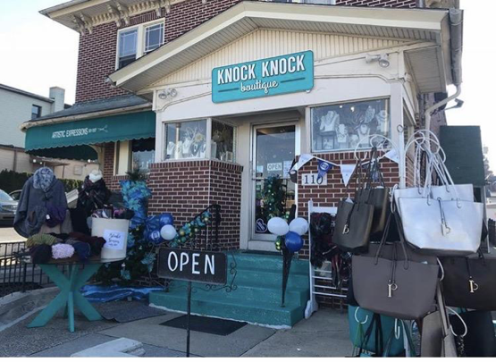 Knock Knock Boutique has a blue sparkly storefront to advertise their statement accessories for shoppers. The blue, white, and black banner represents that they participated in Small Business Saturday. (Credited to Knock Knock's Instagram Page)