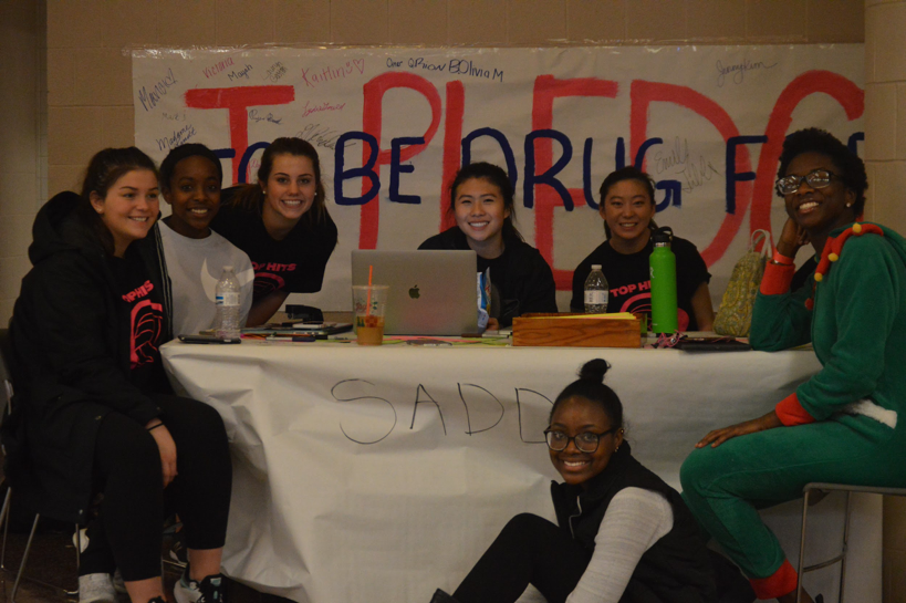 Members of the Students Against Destructive Decisions club pose for a photo. There was  a pledge to be drug free in the lobby at the volleyball tournament. Members pictured are: (L/R) Ryley Longenecker, Lauryn Gaston, Olivia Mcdonald, Jenny Kim, Emily Tubbs, Elsie Robinson, and Cherry Ogbo. (Broadcaster/ Irene Ciocirlan)