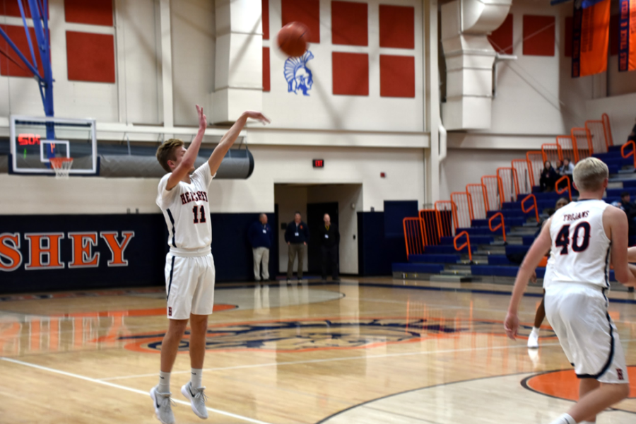 HHS senior Jake Wilson shoots the ball scoring for Hershey against their longtime rival, the Palmyra Cougars. Wilson scored a total of 6 points Friday night helping win the game with a final score of 60-35. (Broadcaster/Katherine Clark)