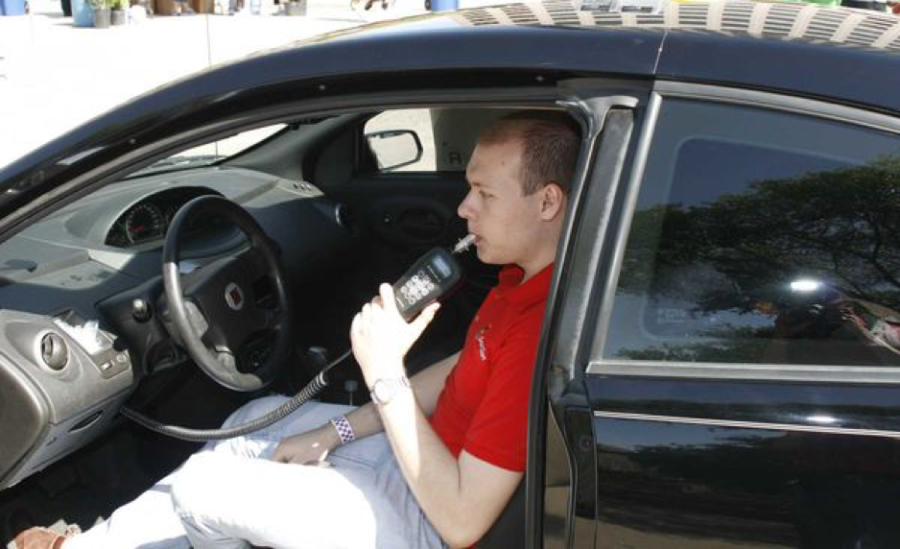 This man is using the ignition lock system to prove he is not under the influence before driving. The ignition lock system will require increased wait time as more tests are failed. (VCU CNS via U.S. Department of Transportation/CC BY-NC 2.0)