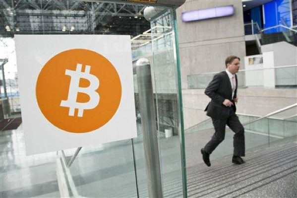 In this April 7, 2014 file photo, a man arrives for the Inside Bitcoins conference and trade show in New York. An Australian man long thought to be associated with the digital currency Bitcoin has publicly identified himself as its creator. BBC News said Monday, May 2, 2016 that Craig Wright told the media outlet he is the man previously known by the pseudonym Satoshi Nakamoto. The computer scientist, inventor and academic says he launched the currency in 2009 with the help of others. (AP Photo/Mark Lennihan, File)