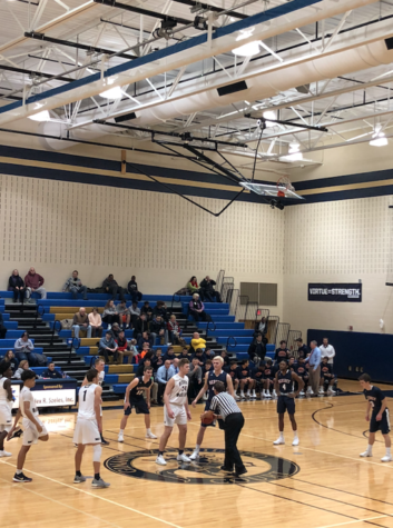 Trojans boys basketball defeats McDevitt Crusaders