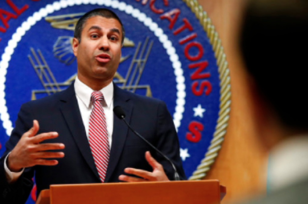 After a meeting voting to end net neutrality, Federal Communications Commission (FCC) Chairman Ajit Pai answers a question from a reporter on Thursday Dec. 14, 2017 in Washington. (AP Photo/Jacquelyn Martin)