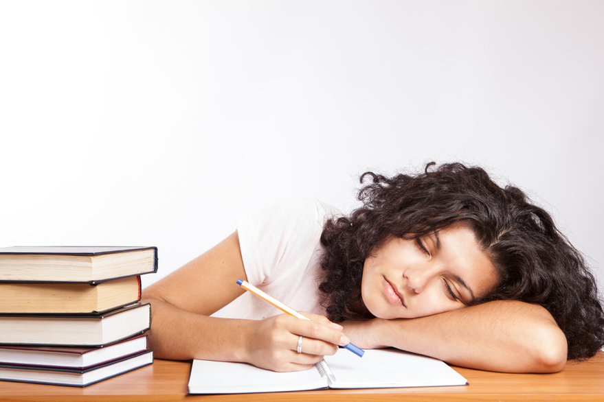 Shown here is a teen so tired she fell asleep during studying. In multiple other schools around the nation, students' academic performance has gone up with the later start times. (CollegeDegrees360/CC BY-SA 2.0)