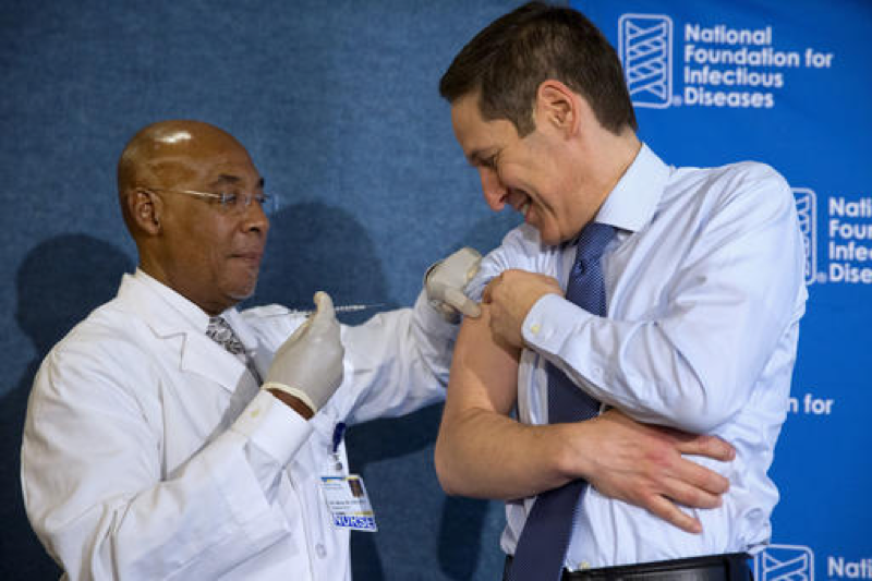Nurse B.K. Morris, left, prepares to give the flu vaccine to Centers for Disease Control and Prevention Director Dr. Tom Frieden, during an event about the flu vaccine, at the National Press Club in Washington on Sept. 17, 2015. A flu shot each year can be a great way to decrease the odds of contracting the flu. (AP Photo/Jacquelyn Martin, File)