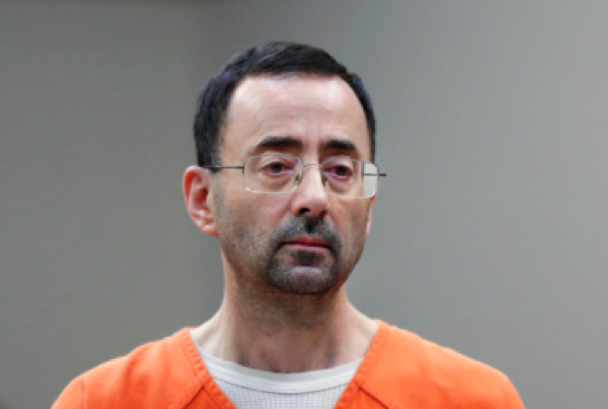 Dr. Larry Nassar, 54, appears in court for a plea hearing in Lansing, Michigan on Nov. 22, 2017. Nasser, a sports doctor accused of molesting girls while working for USA Gymnastics and Michigan State University pleaded, guilty to multiple charges of sexual assault and will face at least 25 years in prison. (AP Photo/Paul Sancya)
