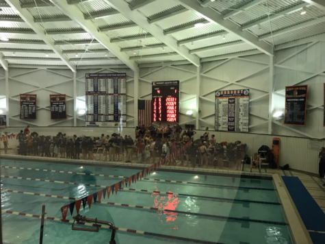 Wilson and Hershey swimmers and divers gather around the edge of the pool to cheer on their teammates in the close races. The Hershey swim team was able to pull out a 106-86 victory over Wilson. (Broadcaster/Brooke Daniels)