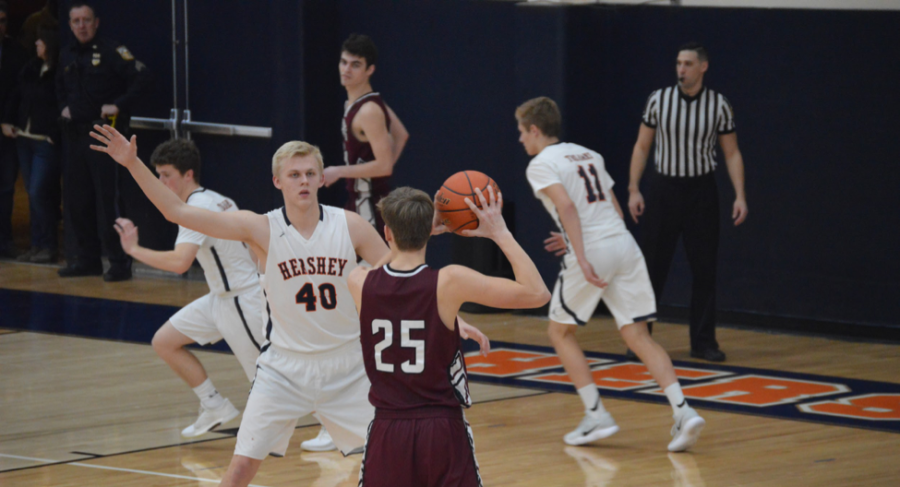 Hershey High School senior Nick Hines (40) covers number 25 as Mechanicsburg attempts to score. Hershey beat Mechanicsburg with a score of 56-27. (The Broadcaster/Evan Spinney)