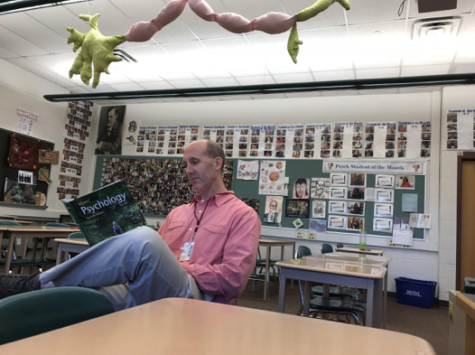 AP Psychology teacher, Pete Steelman, reads the Myers' Psychology for AP 2nd Edition textbook in his classroom on February 28, 2018. AP Psychology was a new course beginning in the 2016-17 school year.(The Broadcaster/Lynn Dang)