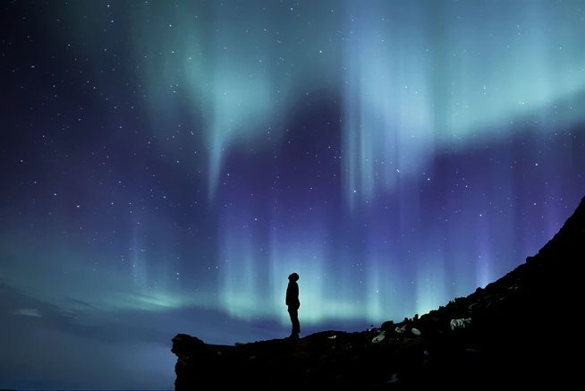 Auroras are created when highly charged particles from the sun interact with elements in the Earth's atmosphere. The Northern and Southern lights appear around their respective magnetic poles. (CC0 Creative Commons/Pixabay)