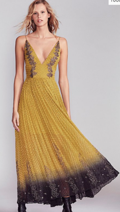 The+plunging+v-neck+with+mustard+yellow+from+Free+People+is+a+different+color+than+most+typical+prom+dresses.+The+embellishment+and+black+add+a+pop+of+contrast.+