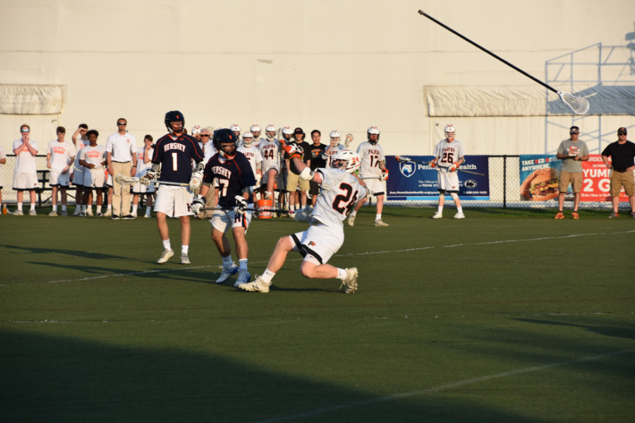 HHS junior Adam Paymer knocks his opponent's lacrosse stick out of his hands. Hershey fell to Palmyra in the final quarter. (Broadcaster/Katherine Clark)