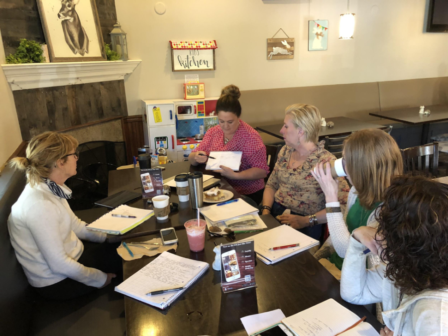 The group listens as Kristin Argento explains the layout for and upcoming event. From left to right: Peggy Bravacos, Kristin Argento, Christine Drexler, Sally Copeland, and Leayn Easterwood. ( Annie Bravacos/ The Broadcaster)