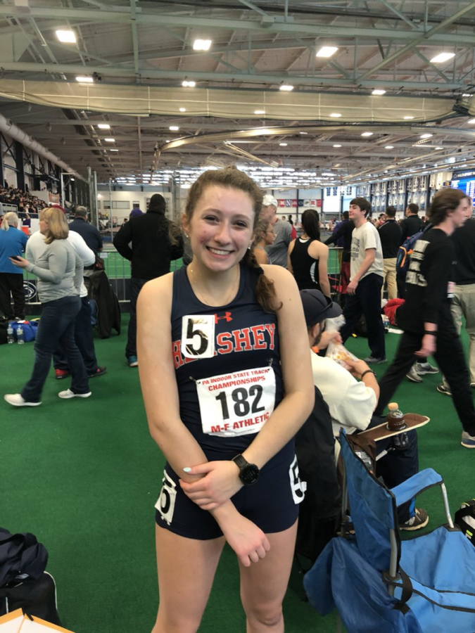 Andie Demko poses for a picture at the 2018 Indoor Track and Field Championships. She broke the school record of a time of 5:14 in the mile.  (Submitted by Andie Demko)
