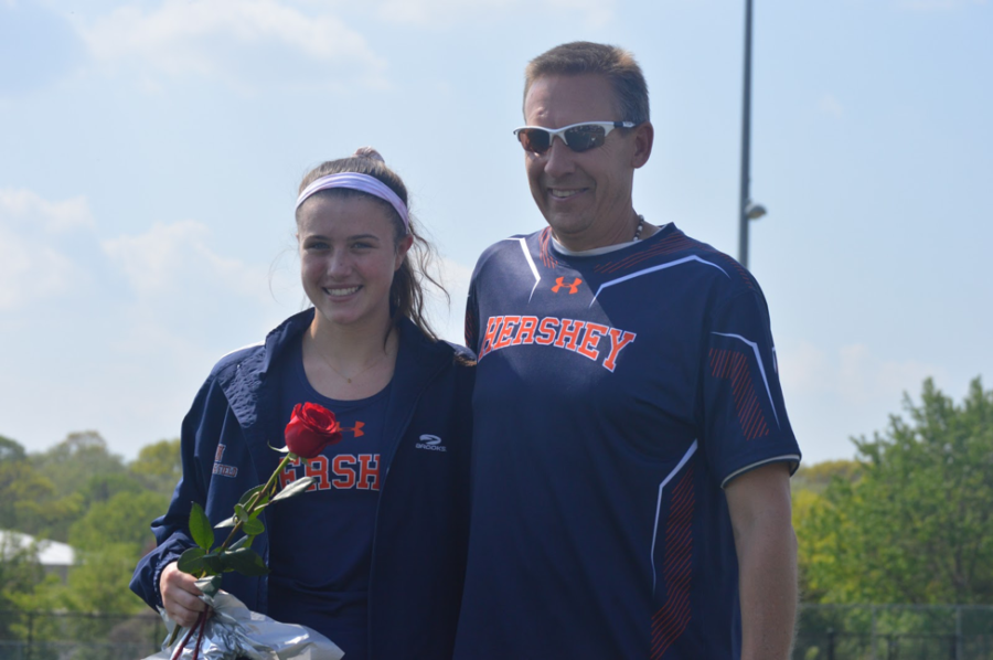 Maggie Miller poses with Coach Kevin Stover on senior night. Miller competes in the 3200m relay, the 1600m, and the 3200m events. (Broadcaster/Alexis Moodie) Maggie Miller poses with Coach Kevin Stover on senior night. Miller competes in the 3200m relay, the 1600m, and the 3200m events. (Broadcaster/Alexis Moodie)