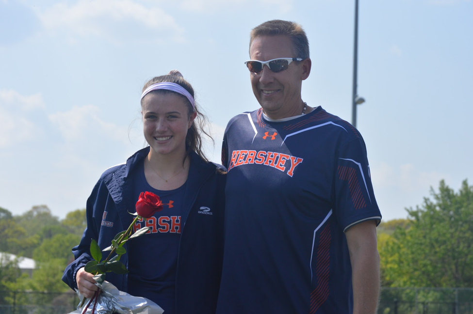 Maggie+Miller+poses+with+Coach+Kevin+Stover+on+senior+night.+Miller+competes+in+the+3200m+relay%2C+the+1600m%2C+and+the+3200m+events.+%28Broadcaster%2FAlexis+Moodie%29%0AMaggie+Miller+poses+with+Coach+Kevin+Stover+on+senior+night.+Miller+competes+in+the+3200m+relay%2C+the+1600m%2C+and+the+3200m+events.+%28Broadcaster%2FAlexis+Moodie%29%0A