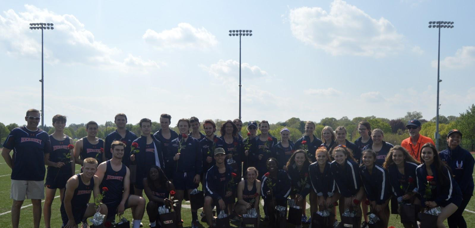 The+30+seniors+that+will+be+graduating+from+the+track+team+this+year+with+coaches+Kevin+Stover+%28Left%29%2C+Coach+Leuschner+%28Right%29%2C+and+Kellie+Stover+%28Far+Right%29.+Nine+of+the+seniors+competed+in+districts+on+May+18+and+19.+%28Broadcaster%2FAlexis+Moodie%29%0A