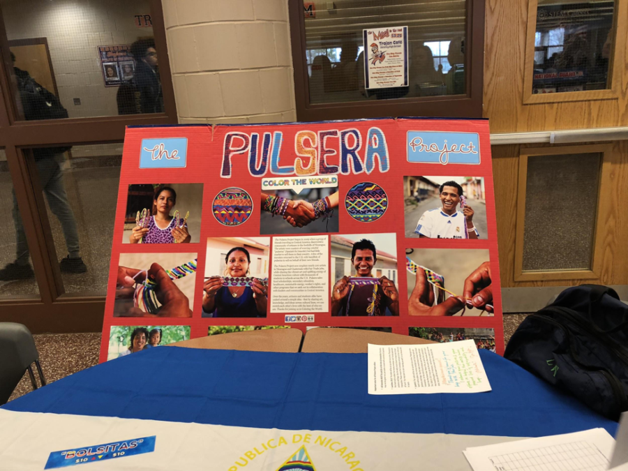 A Pulsera Project sign informs students of the fundraiser on April 11th, 2018. The sign showcased the cause and gave information on prices, benefits, and people involved. (Broadcaster/Keela Delves)